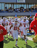 Louisville Cardinals football team takes the field Stock Photos