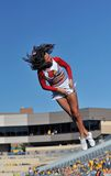 Louisville cheerleader - stunt - mid-air Stock Photo