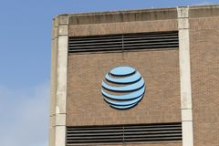 AT&T central office. AT&T wrapped up its merger with WarnerMedia and now controls HBO, CNN, DC Entertainment and DirecTV. Louisville - Circa July 2019: AT&T royalty free stock image