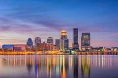 Louisville, Kentucky, USA Skyline. Louisville, Kentucky, USA downtown skyline at the river at dusk royalty free stock images