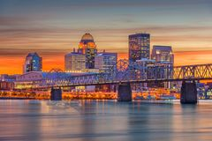 Louisville, Kentucky, USA Skyline. Louisville, Kentucky, USA downtown skyline at the river at dusk stock photo