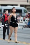 The Pegasus Parade 2018. Louisville, Kentucky, USA - May 03, 2018: The Pegasus Parade, Cheerleader from the University of Louisville dancing using twirling stock image