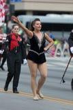 The Pegasus Parade 2018. Louisville, Kentucky, USA - May 03, 2018: The Pegasus Parade, Cheerleader from the University of Louisville dancing using twirling royalty free stock photo
