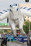 The Pegasus Parade 2018. Louisville, Kentucky, USA - May 03, 2018: The Pegasus Parade, Large balloon in shape of a pegasus carried by people down W Broadway stock images