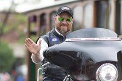The Pegasus Parade 2018. Louisville, Kentucky, USA - May 03, 2018: The Pegasus Parade, Man riding motorcycle waving for the camera stock photography