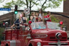 The Pegasus Parade 2018. Louisville, Kentucky, USA - May 03, 2018: The Pegasus Parade, Man women and children riding on an old fire truck from the Louisville royalty free stock photo