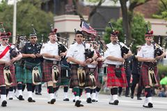 The Pegasus Parade 2018. Louisville, Kentucky, USA - May 03, 2018: The Pegasus Parade, Members of the Louisville fire and rescue pipes and drums band, marching stock image