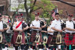 The Pegasus Parade 2018. Louisville, Kentucky, USA - May 03, 2018: The Pegasus Parade, Members of the Louisville fire and rescue pipes and drums band, marching stock photo