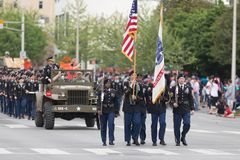 The Pegasus Parade 2018. Louisville, Kentucky, USA - May 03, 2018: The Pegasus Parade, Members of the United States Army marching with rifles, scorting the stock images