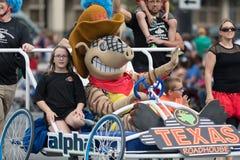 The Pegasus Parade 2018. Louisville, Kentucky, USA - May 03, 2018: The Pegasus Parade, Person dress up as Andy the Armadillo, mascot of the Texas Roadhouse royalty free stock image