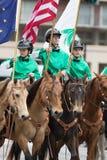 The Pegasus Parade 2018. Louisville, Kentucky, USA - May 03, 2018: The Pegasus Parade, Young women riding horses carrying the american flag stock photography