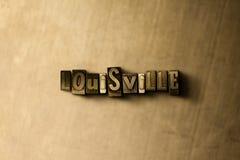 LOUISVILLE - Nahaufnahme des grungy Weinlese gesetzten Wortes auf Metallhintergrund Stockfotos