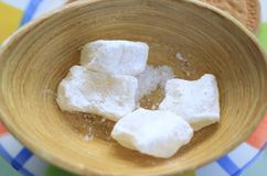 Loukoum in a Wooden Plate. Loukoum cubes covered in white powedered sugar in a wooden plate Royalty Free Stock Photo