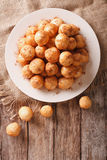 Loukoumades donuts with honey and cinnamon close-up. Vertical to Royalty Free Stock Photo
