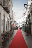 Loule, Portugal - 7 December, 2016: walking on red carpet in town street with christmas decoration. Enjoying shopping in narrow town street with red carpet Stock Photo