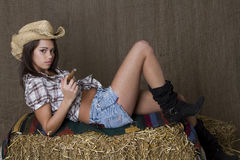 Loundging on bales of straw Stock Image