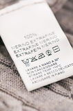 Loundry Symbols on the Wool Clothes Stock Image