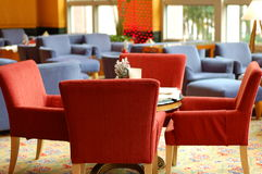 The Lounge. Red sofas and blue sofas at the hotel's lounge Stock Photo