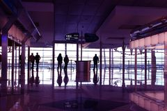 Lounge in airport. People silhouette in the waiting lounge in airport royalty free stock photography