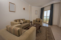 Lounge area of hotel suite room. With view over tropical sea stock image