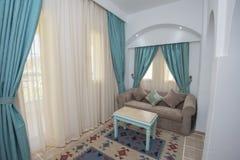 Lounge area of luxury hotel resort room. Lounge area in luxury hotel resort room with sofa and table Royalty Free Stock Photo