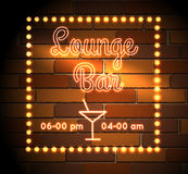 Lounge Bar neon Sight. Neon sign of Lounge Bar on the brick wall. Free font used Royalty Free Stock Images