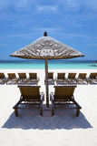 Lounge / Beach chairs in paradise. Royalty Free Stock Photos