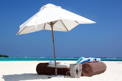 Lounge beds. Lounge bed with parasol on a beach Royalty Free Stock Photo