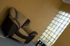 Lounge Chair. Luxury Lounge Setting with glass cube windows Royalty Free Stock Image