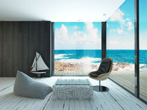 Lounge chair against huge window with seascape view Stock Photography