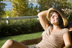 Lounge chair by lake royalty free stock photo