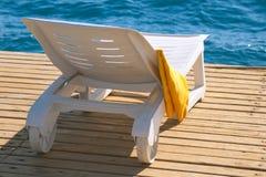 Lounge chair near the sea Royalty Free Stock Photos