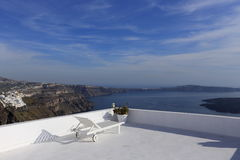 Lounge chair over Santorini caldera, Greece Stock Image