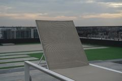Lounge chair on rooftop stock image