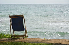 Lounge chair on sandy beach Royalty Free Stock Photo
