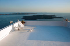 A lounge chair on the terrace in Fira, Santorini, Greece Stock Image
