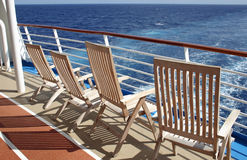 Lounge Chairs. Empty lounge chairs on the stern of a cruise ship stock images