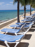 Lounge chairs. A row of lounge chairs at the beach Royalty Free Stock Photo