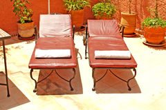 Lounge chairs. Two lounge chairs on the roof Royalty Free Stock Photos