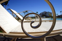 Lounge Chairs. At a homeowners clubhouse, lounge chairs sit waiting for loungers royalty free stock image