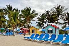 Lounge chairs along the beach Royalty Free Stock Photo
