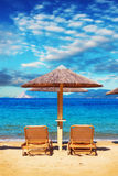 Lounge chairs at Banana beach, Skiathos, Greece Royalty Free Stock Images