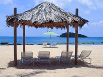 Lounge chairs on beach. A beautiful beach with lounge chairs and huts on St. Croix, US Virgin Islands Royalty Free Stock Image