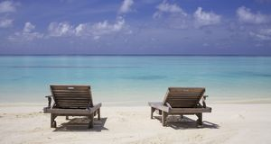 Lounge chairs on Beach Stock Image
