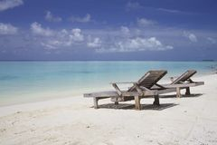 Lounge chairs on Beach Royalty Free Stock Photos