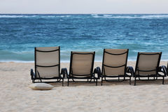 Lounge chairs on beach Royalty Free Stock Photo