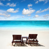 Lounge chairs on the beach Royalty Free Stock Photography