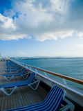 Lounge Chairs on Deck. A row of lounge chairs on the deck of a cruise ship stock photos