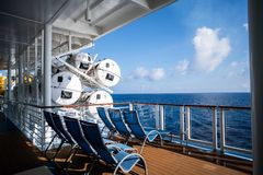 Lounge chairs on deck of cruise ship royalty free stock images