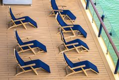 Lounge chairs on deck of cruise ship. Lounge chairs on a deck of cruise ship royalty free stock photo